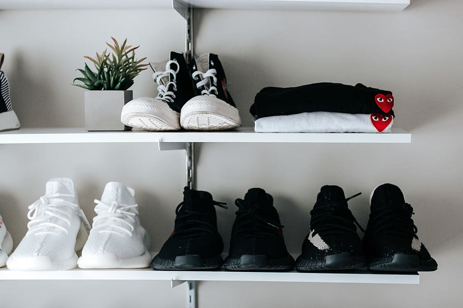 Tennis shoes lined up on a shelf