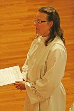 Photo: Michelle Boomgaard listens to the bishop's challenge
