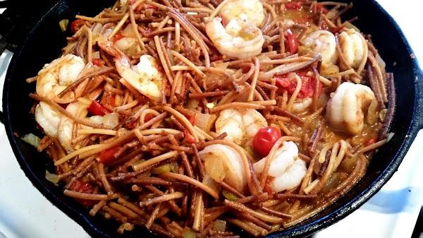 Place a dollop of sour cream in serving bowls & ladle desired pasta, shrimp...