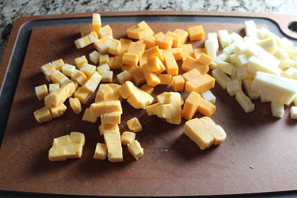 Cut cheese into small cubes.