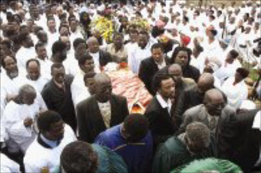 Throngs At Burial Of Popular Singer-3247