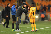 Kaizer Chiefs Italian coach Giovanni Solinas speaks to winger Kabelo Mahlasela during the MTN8 3-0 quarterfinal win over Free State Stars at FNB Stadium on August 11, 2018 in Johannesburg, South Africa.