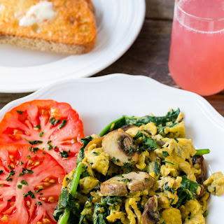 Scrambled Eggs with Cheese, Basil, Spinach and Mushrooms.