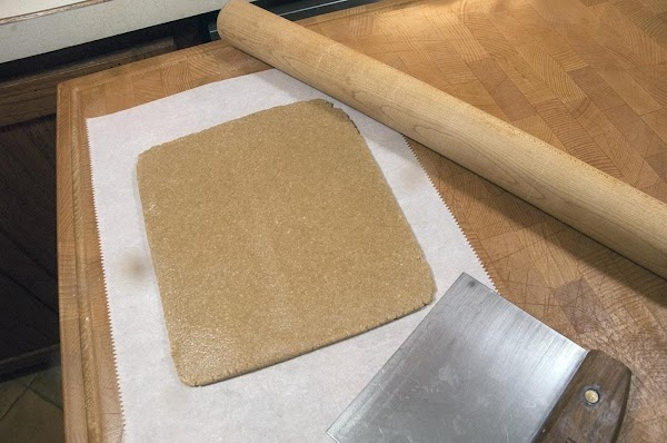 Lay the dough onto a piece of parchment paper, and form into a rectangle...