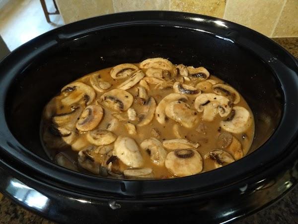 Put meat and onion mixture in crock pot.  Stir in mushrooms.  Pour...