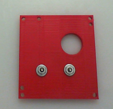 Photo: The top-plate with the connecting screws for the worm-gear motor. Here I used a #6 nut and washer to make up the distance between the worm-gear mount (That little black plate connected to the front of the motor) and my 3D-printed plates.