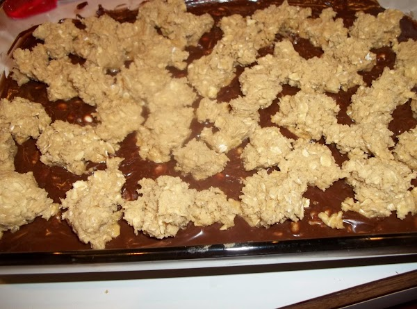 Pour over mixture in pan. Spread evenly.  Dot with remaining oatmeal mixture.
