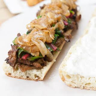 Maple Glazed Seitan Sandwiches w/ Beer-Braised Onions & Garlic, Swiss Chard, & Horseradish Cream.