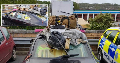 Driver arrested for car filled and stacked with household items