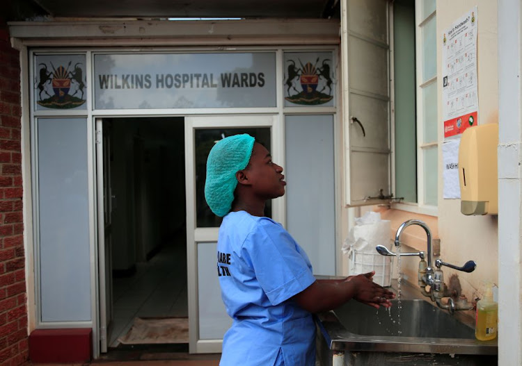 A health worker washes her hands during a demonstration of preparations for coronavirus cases at a hospital in Harare, Zimbabwe, on March 11 2020.