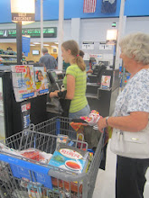 Photo: We finally decided that we'd better head back and give the guys a break from the boys... so we headed to self check out and Robyn got to be our cashier!