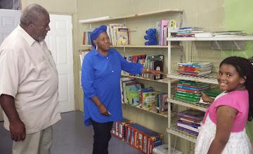 Photo: Kaleya explaining where books are located