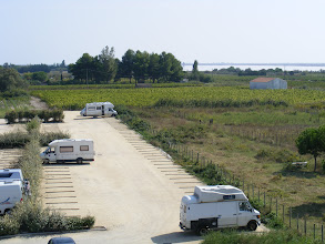 Photo: Here past the camper parking is the other main industry of the town: vineyards for wine making cover 75% of the municipality. It is the Rhône river that dominates the area here, giving rise to (of course) the many Côtes du Rhône vintages.