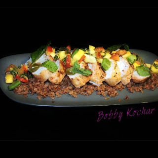 Grilled Chicken On A Bed Of Red Rice With Mango Salsa