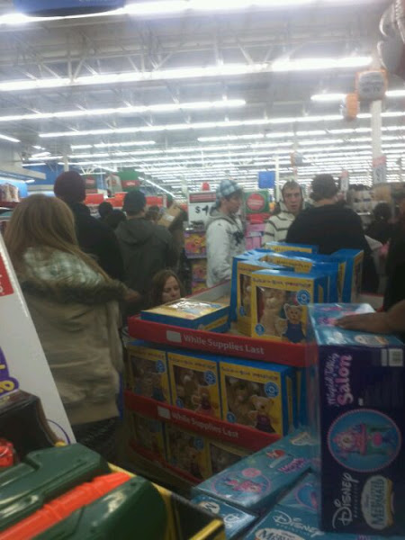 Photo: The crowds around where certain toys were opened and now available.