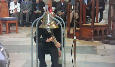Photo: Seven Bells struck on the bell of HMS Exeter at the commencement of the service