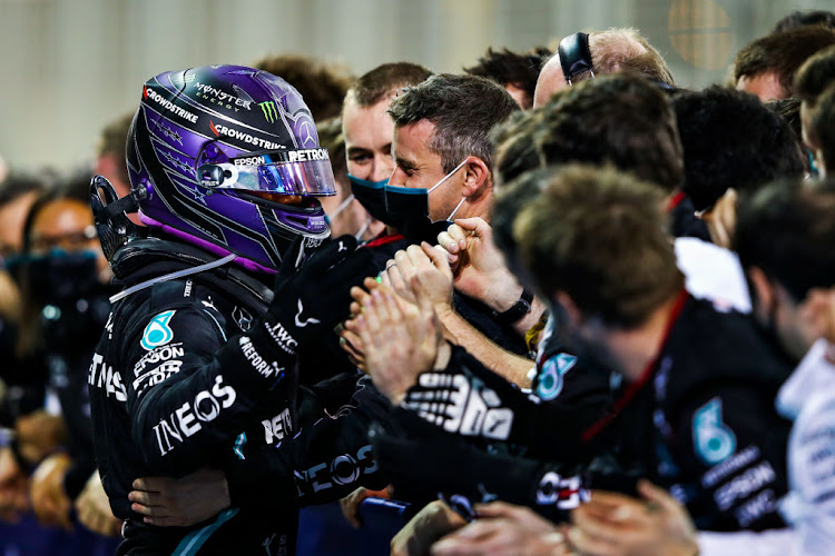 Race winner Lewis Hamilton of Great Britain and Mercedes GP celebrates in parc ferme during the F1 Grand Prix of Bahrain at Bahrain International Circuit on March 28, 2021 in Bahrain, Bahrain.