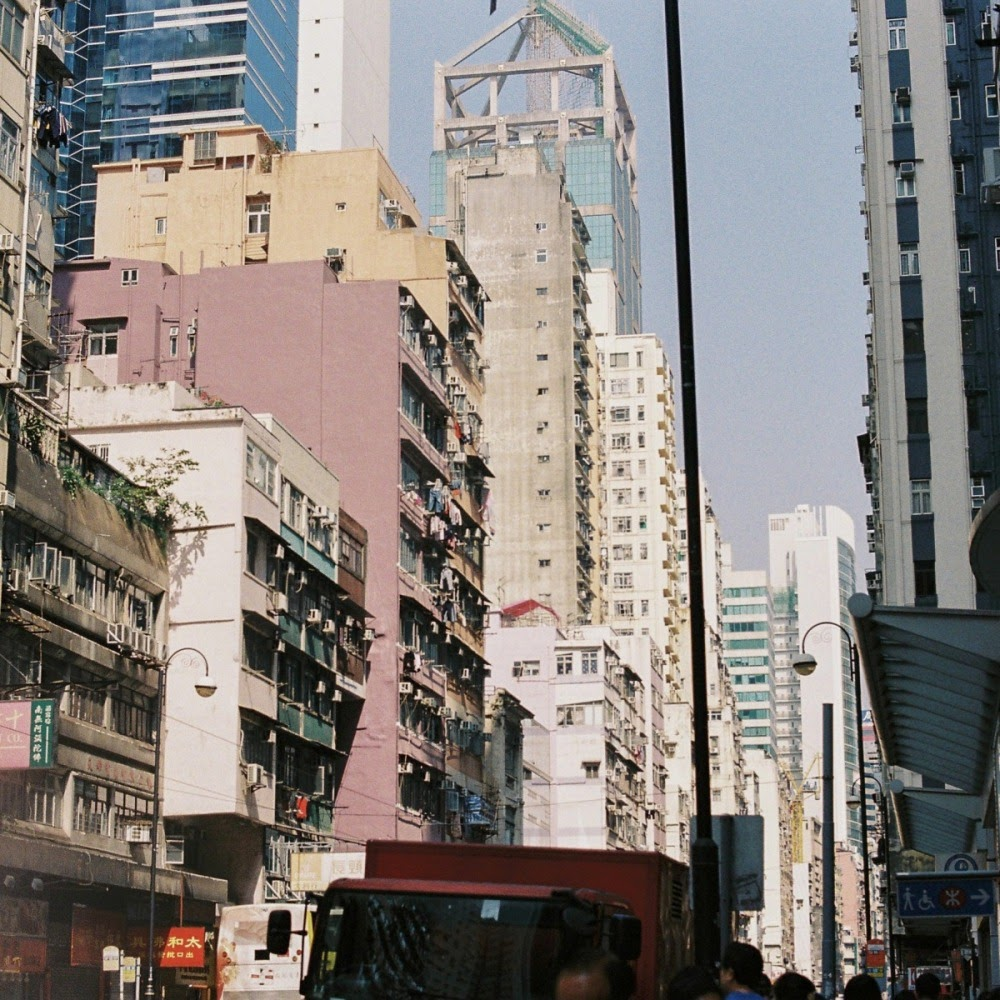 HK buildings. pastel sun.