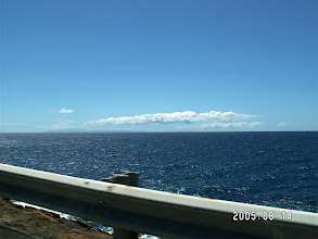Photo: Orographic cloud trails from Maui and Big Island, viewed from near Blowhole, Oahu.   Maui is visible easily.  I half think I see Big Island to its right.  Supposedly, this kind of cloud can help lost sailors find an island they cannot see.