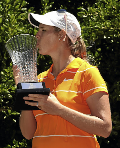 Well worth the effort: Ashleigh Buhai meets the trophy. Picture: LUKE WALKER/GALLO IMAGES
