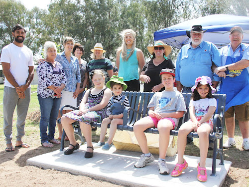 The first people to try out the new seat after its official opening were youngsters Alyssa Christie, Andiah Walsh, Lucas and Anthea O'Regan, watched over by some of the official party in Jas Singh (Lifestyles4U), Narrabri Shire Mayor Cathy Redding, Life Worth Living secretary Maree Clark, Margaret Wheeler and Lynda George (Lifestyles4U members), Karla Carruthers (Lifestyles4U), Life Worth Living committee member Joanne Gordon, Life Worth Living chairman Phill Matthews and Narrabri Lions Club member Rob Gilbert.