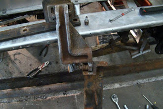 Photo: Photo of the underside of the right rail sweep showing how the rail sweep is attached to the axle frame.  Photo by J. Loucks
