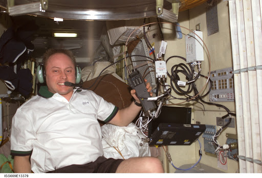 Fincke talks on the ISS Ham radio in the FGB during Expedition 9