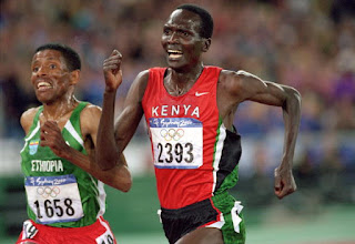 Photo: 25 Sep 2000:  Paul Tergat of Kenya is overtaken by Haile Gebrselassie of Ethiopia down the home straight of the Mens 10000m Final at the Olympic Stadium on Day 10 of the Sydney 2000 Olympic Games in Sydney, Australia. \ Mandatory Credit: Stu Forster /Allsport