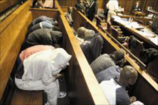 CAMERA SHY: Jeppestown massacre accused in the Johannesburg high court. Pic. Vathiswa Ruselo. 06/02/08. © Sowetan.