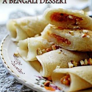 Patishapta (A Bengali Dessert), rice flour pancakes with coconut and khoya filling.