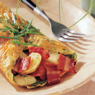 Omelets with Potatoes, Bacon, and Fresh Chives.
