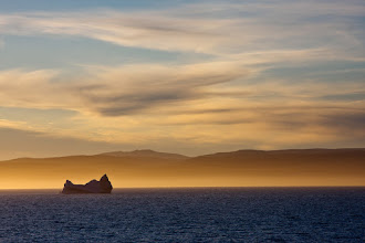Photo: A lone iceberg floats by.