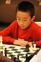 Photo: One of the top scholastic players in the state, sixth grader Max Sun contemplating how to finish the win against his first round opponent, Ashwin Sah.