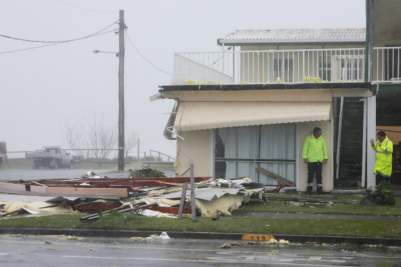 Photo: GOLD COAST, AUSTRALIA - JANUARY 28:  Police at the scene of a roof collapse in Tugun as Queensland experiences severe rains and flooding from Tropical Cyclone Oswald on January 28, 2013 in Gold Coast, Australia. Hundreds have been evacuated from the towns of Gladstone and Bunderberg while the rest of Queensland braces for more flooding.  (Photo by Chris Hyde/Getty Images)