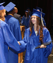 Photo: Graduate Lindsey Anne Ellise is congradulated by class officers.