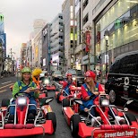 driving through Shibuya Crossing in Mario Karts in Tokyo, Tokyo, Japan