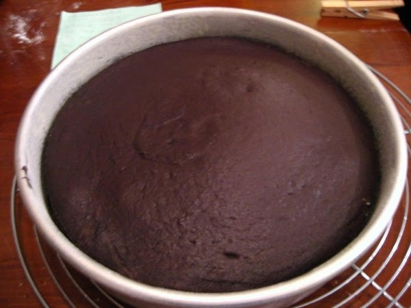 CAKE: Preheat oven 350°F and butter and line a 9″ spring form pan.Melt the...