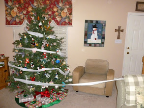 Photo: December 17: Toilet paper rolled around the Christmas tree