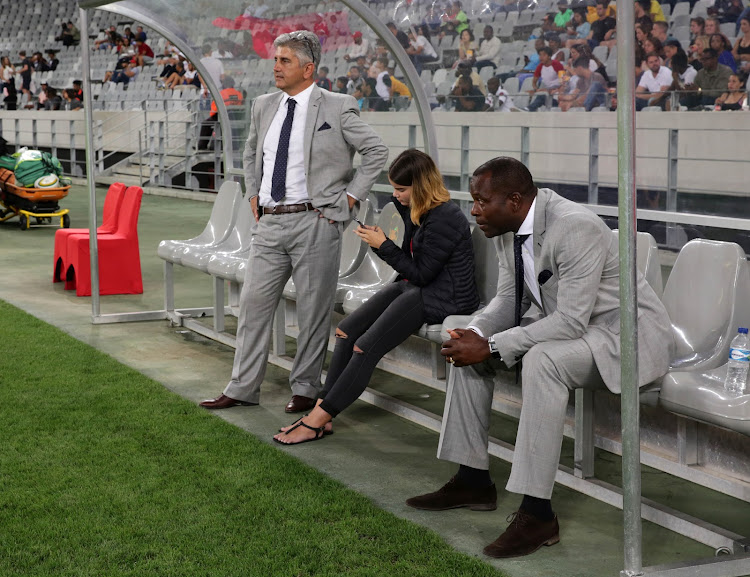 Ari Efstathiou, Chairman of Ajax Cape Town (l) and Stanley Menzo, Head Coach of Ajax Cape Town (r) during the Absa Premiership 2016/17 football match against Cape Town City FC at Cape Town Stadium on 11 February 2017.