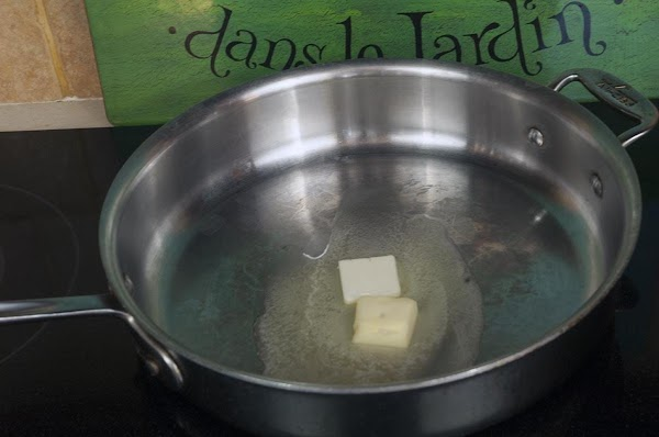 Add two tablespoons of butter to a skillet over medium high heat.