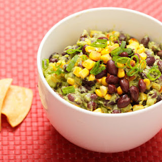 Guacamole With Charred Corn, Black Beans, and Scallions