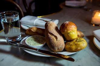 Photo: A mini warm, crusty baguette, thick-sliced sourdough, a large olive roll and a hot, buttery brioche - all served with housemade seaweed butter at Maison Premiere.