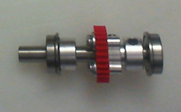 """Photo: Step 6 of the installation, here you can see main drive shaft with my own 3D-printed cog that mates with the worm-gear (making the Cog in Blender so I could 3D print it first, then CNC an aluminum one, was the hardest part of the 3D modelling design). I also added two aluminum set-screw collars. These hold the shaft in place inside the super-worm, so only the business-end of the shaft extrudes outwards. You can also get 4""""+ long shafts if needed!"""