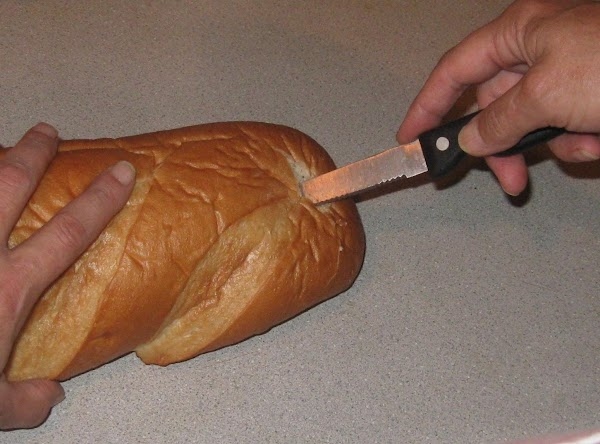 HOLLOWING OUT BREAD Using a serated knife hold knife straight down and starting at end...