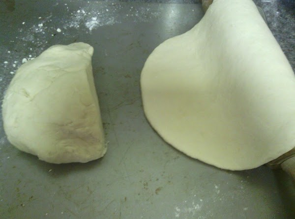 Split the dough in to two balls, one ball being 2/3's of the dough....