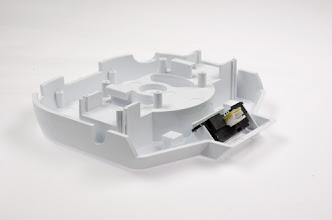 Photo: Mounting distance measuring sensor unit on lower body part.  sensor unit:Sharp GP2Y0A21YK  Available at: http://www.switch-science.com/catalog/40/ http://international.switch-science.com/catalog/40/