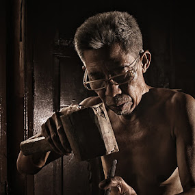 The Wood Carver by Lucky E. Santoso - People Portraits of Men ( senior citizen )