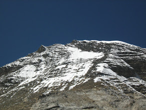 Photo: Summit camp was above the rockface seen in the right