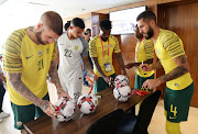 Lars Veldwijk, Ronwen Williams, Thulani Hlatshwayo and Daniel Cardoso of South Africa sign the Afcon tournament official ball at Novotel Hotel in Cairo, Egypt, on June 20 2019.