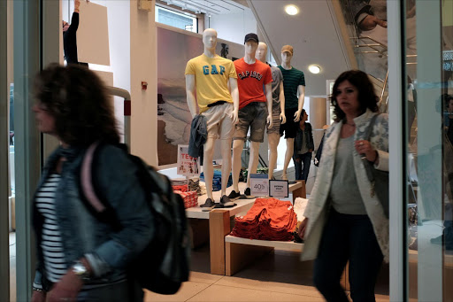 Shoppers leave a clothing store in Manhattan, New York. Apparel prices edged up 0.1% after jumping 0.9% in September. Picture: REUTERS